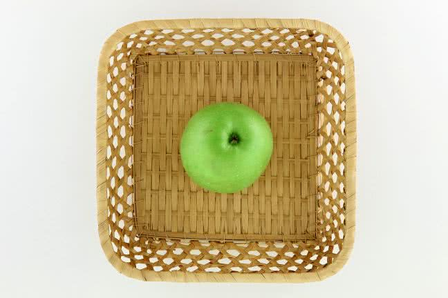 Apple in a small basket - free stock photo