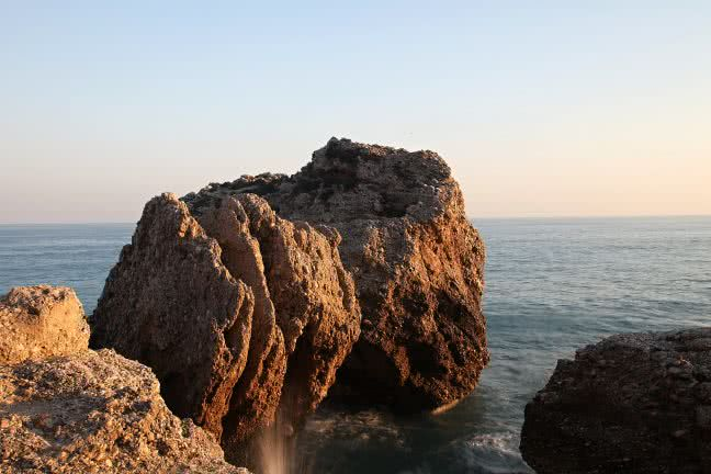 Rock in the sea in Nerja - free stock photo