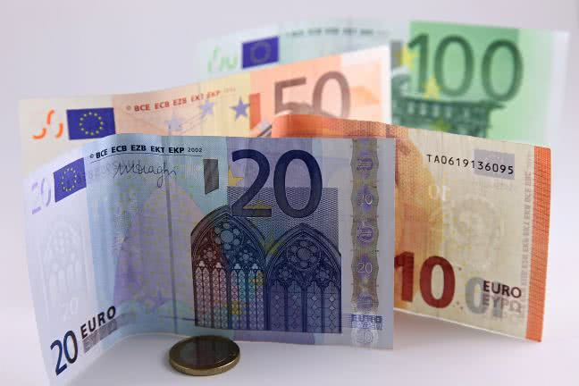 Euro banknotes and a coin - free stock photo