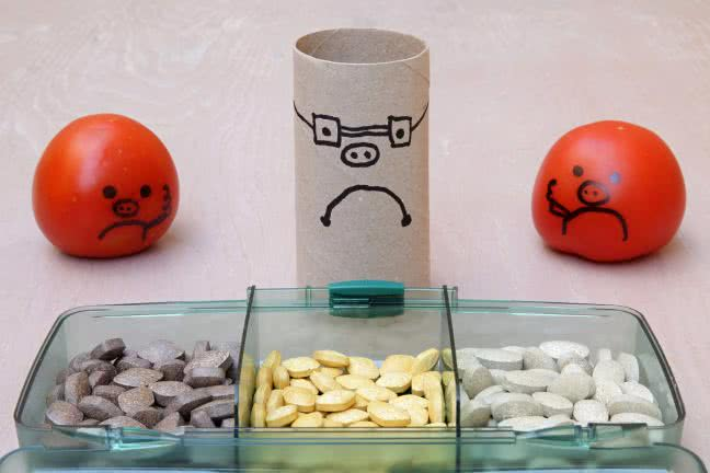 Group of unhappy smiley faces watching vitamins - free stock photo