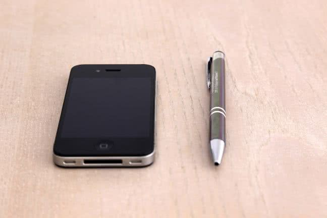 iPhone and a pen - free stock photo
