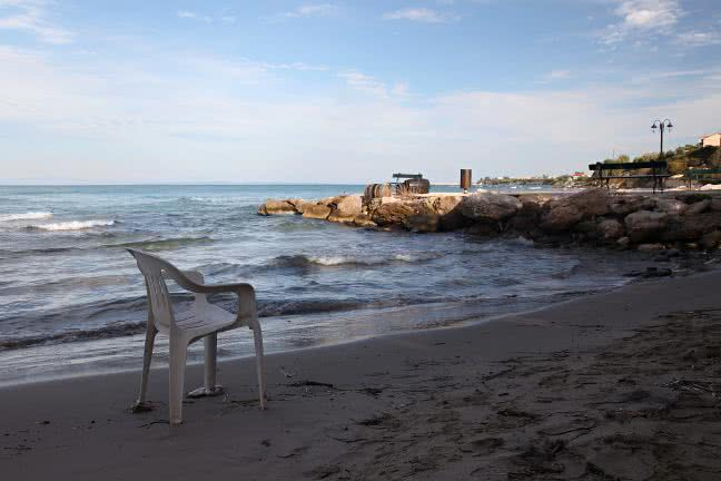 Plastic chair on the sea coast - free stock photo