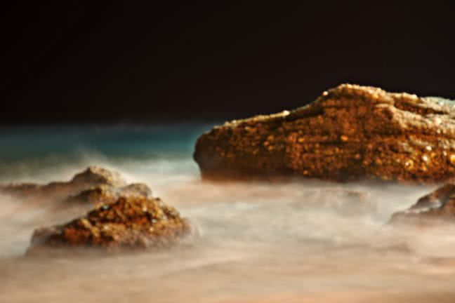Rocks in the sea at night - free stock photo