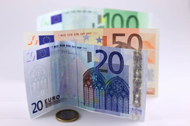 Three euro notes and one coin - free stock photo